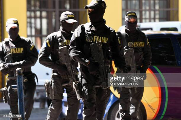 Members of Honduras' AntiGangs National Force patrol the streets of Tegucigalpa on November 21 2018 More than 30000 Honduran police and military...
