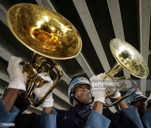 Members of Houston's Sterling High School marching band play under a freeway at the end of the Martin Luther King Jr Grande Parade January 15 2007 in...