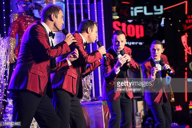 Members of Human Nature perform on stage at Associated Television International's 2012 Hollywood Christmas Parade Concert at Universal CityWalk's 5...