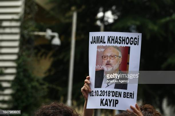 Members of Human Rights Association's Istanbul branch office hold banners as they gather for a news release on the disappearance of Saudi journalist...