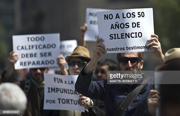 Members of human rights organizations protest in front of the presidential Palace La Moneda in Santiago on October 03 2014 The relatives of...