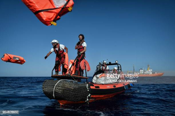 Members of humanitarian organisations SOS Mediterranee and Medecins Sans Frontieres perform a rescue drill during a joint operation at the MV...
