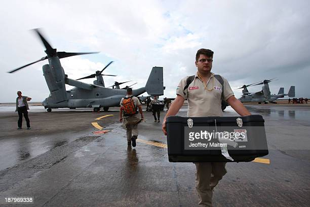 Members of Hungary Emergency Response Team arrive at the airport to help survivors in the aftermath of Typhoon Haiyan on November 14 2013 in Tacloban...