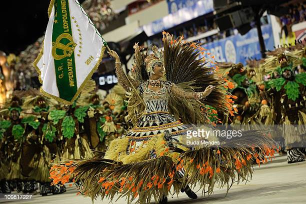 Members of Imperatriz Leopoldinense dance during the samba school's parade at Rio de Janeiro's carnival on on March 06 2011 in Rio de Janeiro Brazil...
