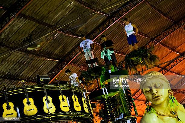Members of Império Serrano samba school test the carry capacity of a carnival float inside the workshop in Rio de Janeiro Brazil 14 February 2012 The...
