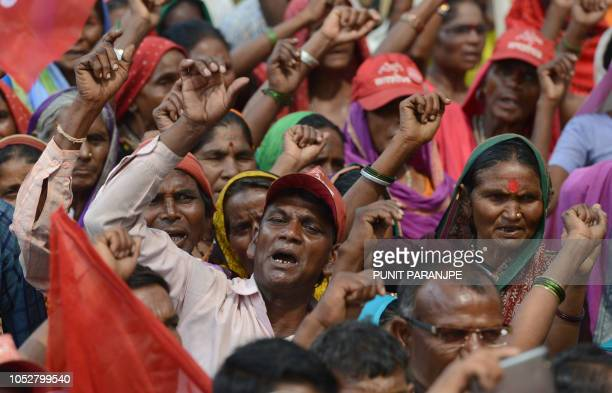 Members of Indian tribal groups shout slogans during a protest in Mumbai on October 23 2018 Thousands of members of Indian tribal and farmers...