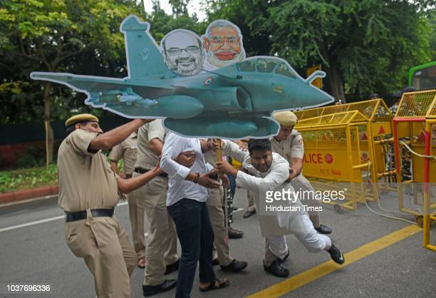 Members of Indian youth congress protest against central government over the Rafale deal during a protest march from AICC towards PM House at Akbar...