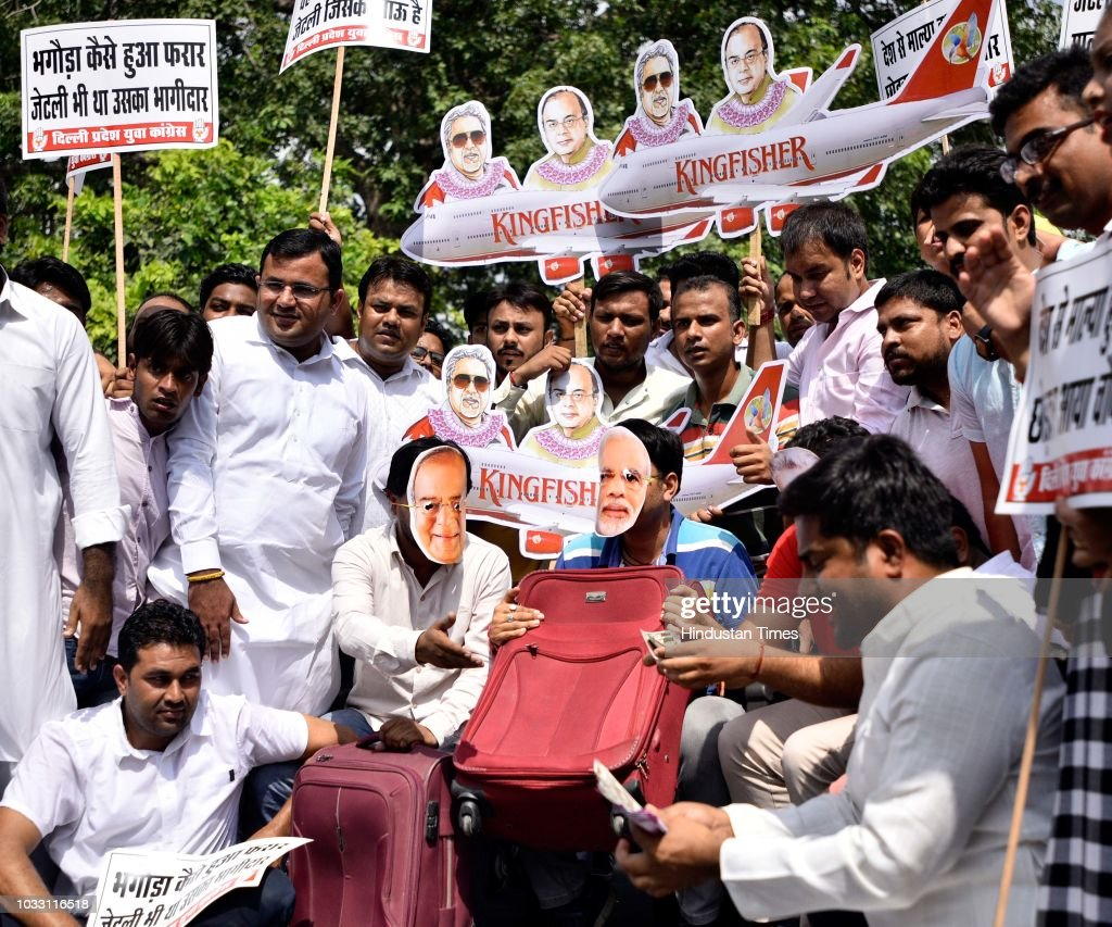 Members of Indian Youth Congress protest against Finance Minister Arun Jaitley and businessman Vijay Mallya at Udyog Bhawan, on September 14, 2018 in New Delhi, India. Vijay Mallya, who founded the now-defunct Kingfisher Airlines, fled India in March 2016 even as a debt court in Bangalore was set to act against him for defaulting on loans issued by several banks led by the state-owned State Bank of India. He is in London and fighting an effort to get him extradited to India. A court will pronounce its verdict in this case on December 10.