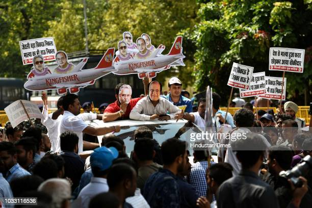 Members of Indian Youth Congress protest against Finance Minister Arun Jaitley and businessman Vijay Mallya at Udyog Bhawan on September 14 2018 in...