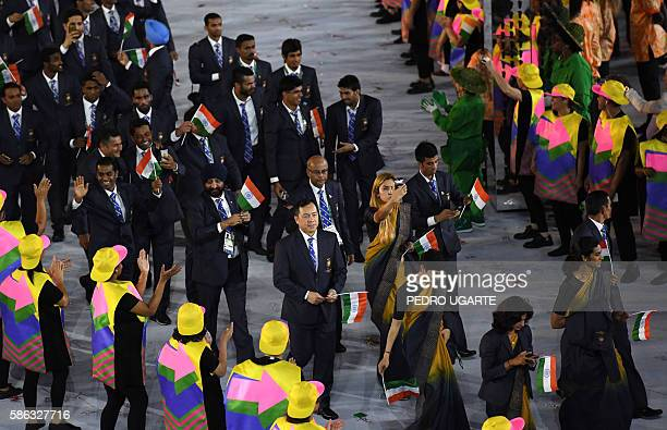 Members of India's delegation parade during the opening ceremony of the Rio 2016 Olympic Games at the Maracana stadium in Rio de Janeiro on August 5...
