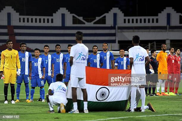 Members of India's football team stand in front of the Indian flag as the national anthem is played prior to the Asia Group D FIFA World Cup 2018...