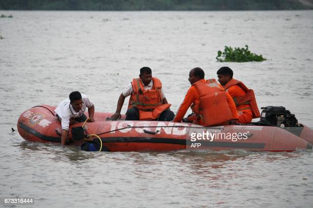 Members of India's National Disaster Response Force search for survivors of a jetty collapse in the Hooghly River in Bhadreswar in Hooghly district...