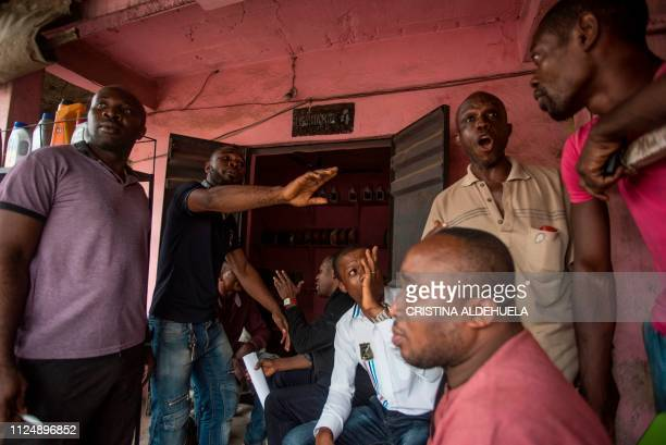 Members of Indigenous People of Biafra talk with each others about the upcoming Nigerian General Elections on February 14 in a meeting held in a shop...