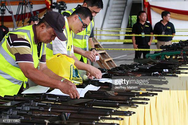 Members of International Decommissioning Body in charge of safekeeping the weapons of Philippines largest Muslim rebel the Moro Islamic Liberation...