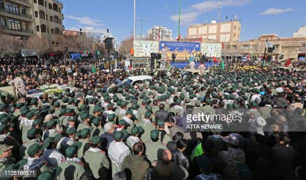 Members of Iranian revolutionary guards corps attend the funeral of fellow guards who were killed in a suicide attack in the central Iranian city of...