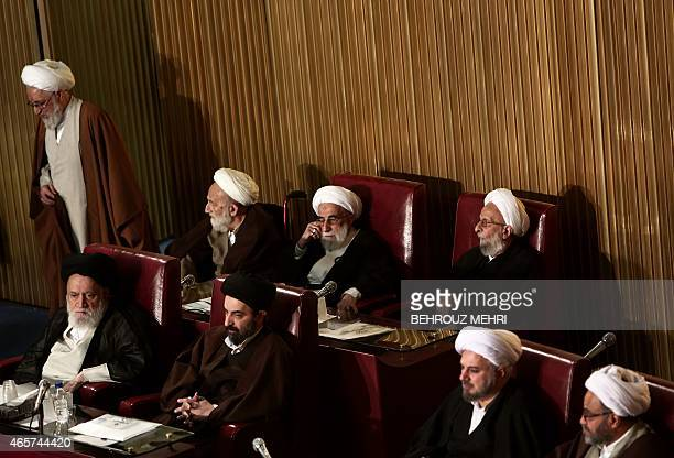 Members of Iran's Assembly of Experts Mohammad Taghi MesbahYazdi and head of the Guardian Council Ahmad Jannati attend a session to appoint a new...