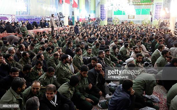 Members of Iran's elite Revolutionary Guard Corps attend a ceremony marking the 35th anniversary of the return from exile of the founder of Iran's...