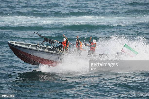 Members of Iran's elite Revolutionary Guard flash a victory sign as they carry naval exercises in the Gulf on April 22 2010 Iran's elite...