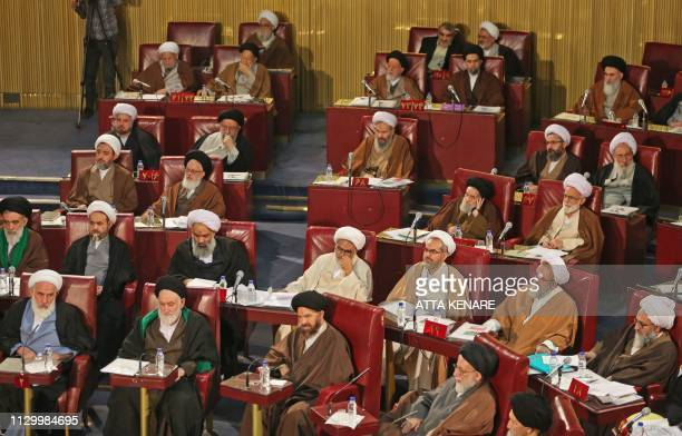 Members of Iran's influential experts assembly attend a session in Tehran on March 12, 2019.