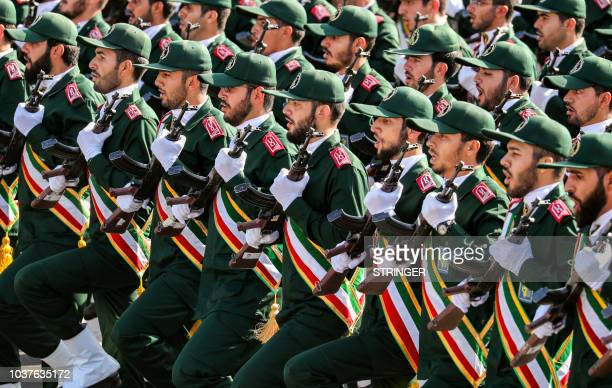 Members of Iran's Revolutionary Guards Corps march during the annual military parade marking the anniversary of the outbreak of the devastating...