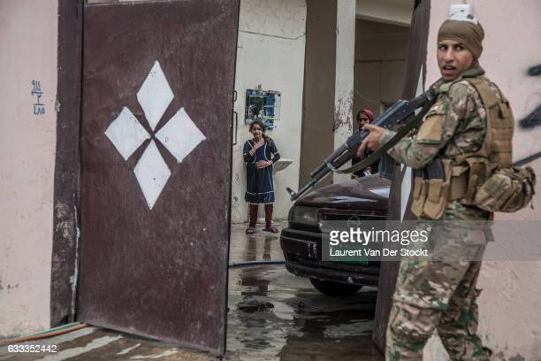 Members of Iraqi Special Operations Forces search houses of Gogjali an eastern district of Mosul looking for Islamic State members equipment and...