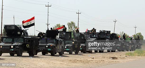 Members of Iraq's anti-terror brigade are seen on a road between Baghdad and Samarra, as they make their way to the Balad area, north of the capital...