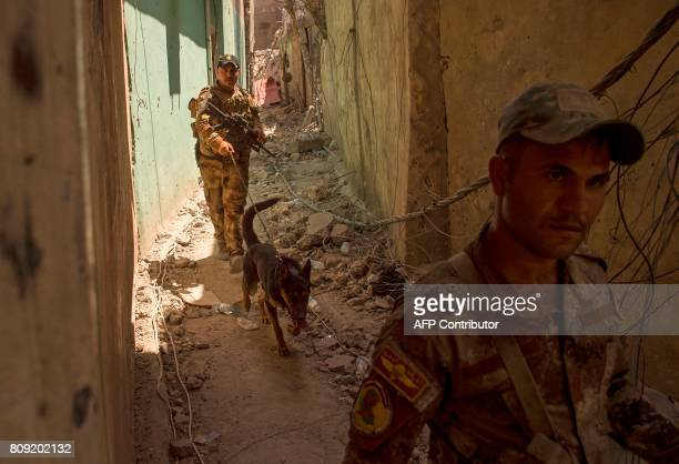 Members of Iraq's CounterTerrorism Service advance in the Old City of Mosul on July 5 during the government forces' ongoing offensive to retake the...
