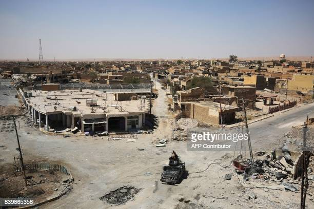 TOPSHOT Members of Iraq's CounterTerrorism Service patrol a road in Tal Afar's Qalea central district during an operation to retake the city from the...