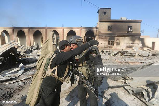 Members of Iraq's elite counterterrorism celebrate on December 28 2015 at the heavily damaged government complex after they recaptured the city of...