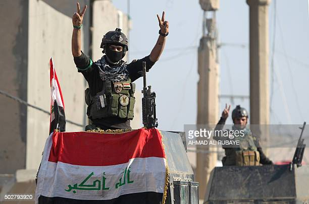 Members of Iraq's elite counterterrorism service flash the 'V' for victory sign on December 29 2015 in the city of Ramadi the capital of Iraq's Anbar...