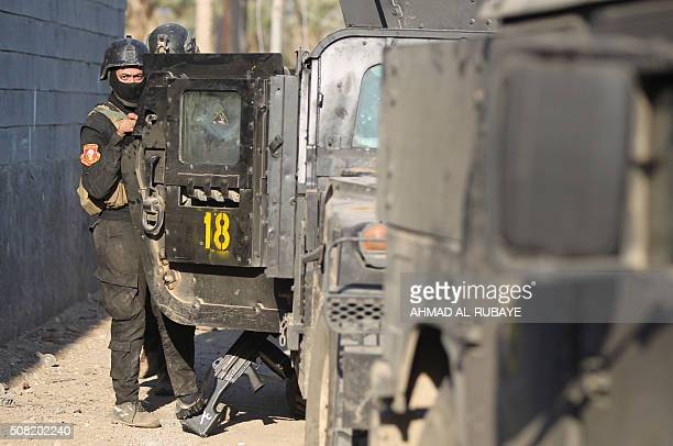 Members of Iraq's elite counterterrorism service patrol suburbs as they progress towards alSajariyah area east of the city of Ramadi the capital of...
