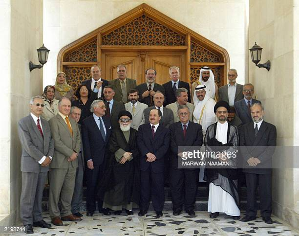 Members of Iraq's Governing Council pose for a picture following their meeting at the former Ministry of Military Industry in central Baghdad 13 July...