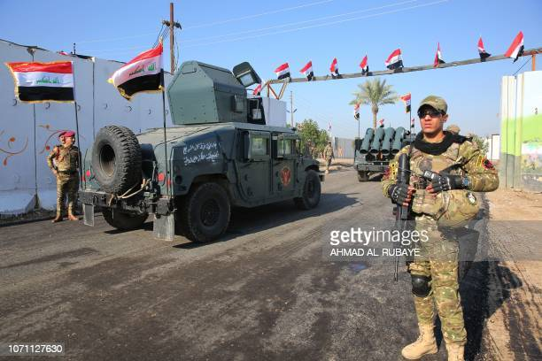 Members of Iraq's Rapid Response military are pictured next to armoured vehicles during a ceremony held on December 10 2018 at a military base inside...