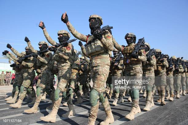 Members of Iraq's Rapid Response military unit parade during a ceremony at a military base inside Baghdad's International Airport marking the first...