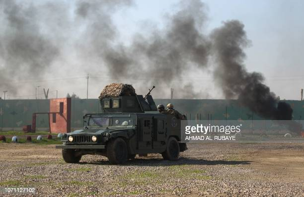 Members of Iraq's Rapid Response military unit show their skills during a drill at a military base inside Baghdad's International Airport marking the...