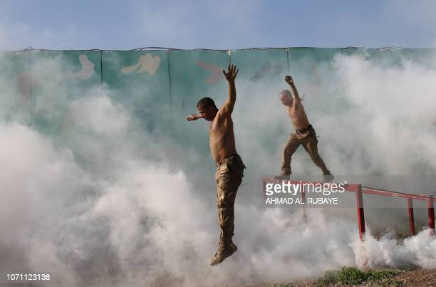 Members of Iraq's Rapid Response military unit take part in a demonstration at a military base inside Baghdad's International Airport to mark the...