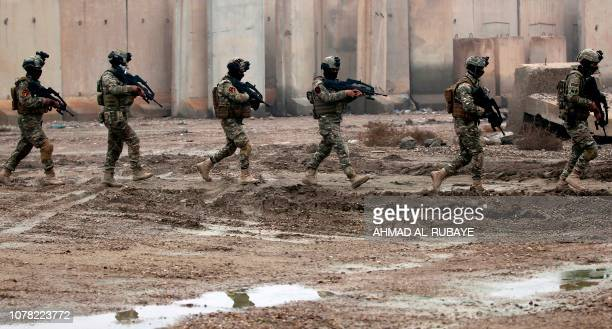 Members of Iraq's Rapid Response military unit take part in a 'counterterrorism' training at a military base inside Baghdad International Airport on...