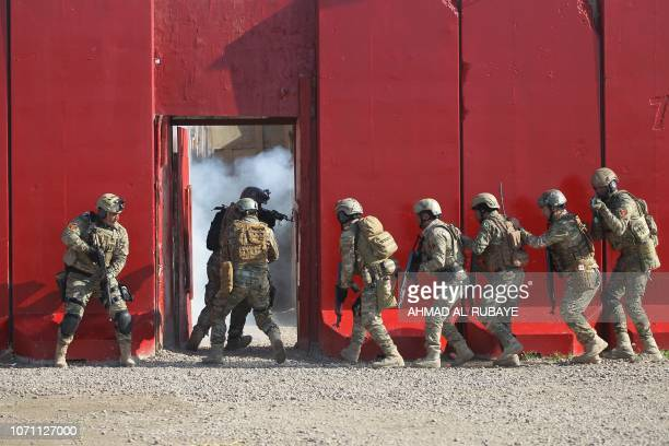 Members of Iraq's Rapid Response military unit take part in a drill at a military base inside Baghdad's International Airport to mark the first...