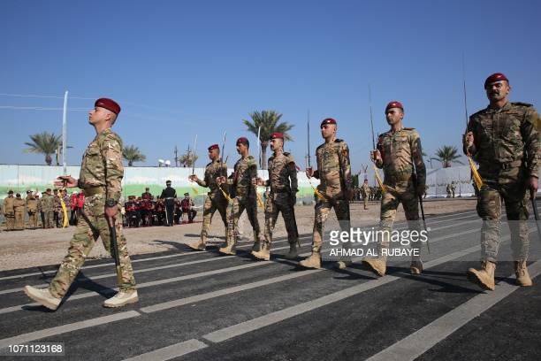 Members of Iraq's Rapid Response military unit take part in a parade at a military base inside Baghdad's International Airport to mark the first...
