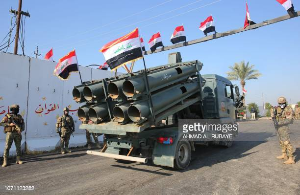 Members of Iraq's Rapid Response military unit take part in celebrations at a military base inside Baghdad's International Airport to mark the first...
