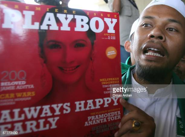 A members of Islamic Defender Front holds the premiere issue of Playboy magazine during an antiPlayboy magazine demomstration outside publisher's...