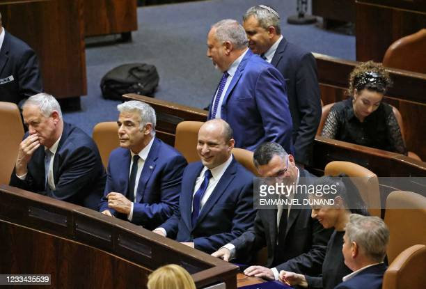 Members of Israel's newly-sworn government Defence Minister Benny Gantz, Alternate Prime Minister and Foreign Minister Yair Lapid, Prime Minister...