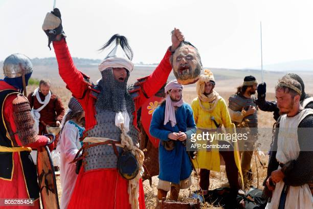 Members of Israel's Regnum Hierosolimitanum knights club wearing costumes of Crusaders and Salaheddin's army rehearse on July 1 2017 at a camp...