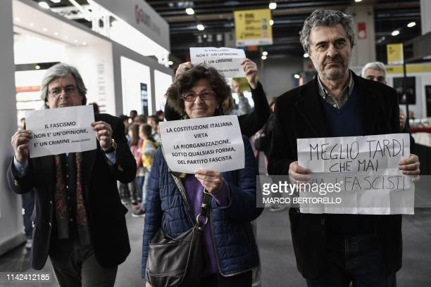 """Members of Italian Communist Refoundation Party hold placards reading """"Fascism is not an opinion, it's a crime"""", """"The Italian constitution prohibits..."""