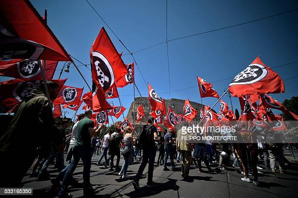 Members of Italian far-right political movement CasaPound march with flags near the Colosseum during a demonstration on May 21, 2016 in Rome. AFP...