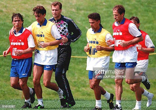 Members of Italy's World Cup soccer team run a lap to cool off at the end of their training session 14 June 1994 at the Pingry School in New Jersey...