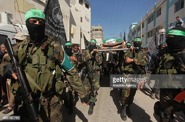 Members of Izz ad-Din al-Qassam Brigades, military wing of Hamas, hold funeral ceremony of Hamad Elian al-Hassanat, who is one of the founders of...