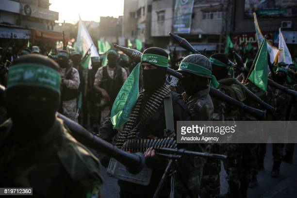 Members of Izz adDin alQassam Brigades the armed wing of the Palestinian Hamas movement take part in a military parade on the third anniversary of...