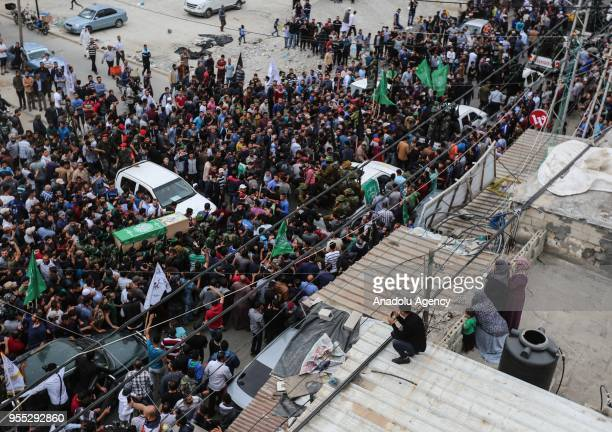 Members of Izz adDin alQassam Brigades which is the military wing of the Palestinian Hamas organization carry the coffins during the funeral ceremony...