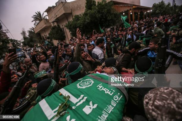 Members of Izz adDin alQassam Brigades which is the military wing of the Palestinian Hamas organization carry the dead body of Beha Abdurrahman Kadih...